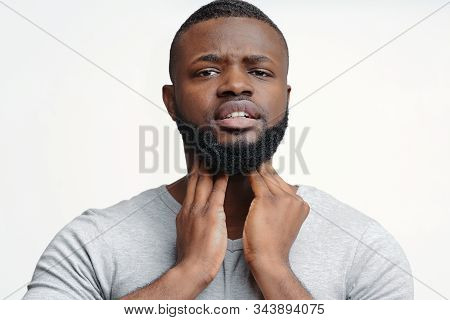 Young Afro Man Suffering From Chronic Pharyngitis, Palping His Neck
