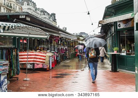 Vienna, Autria - May 22, 2019: These Are The Row Of  Counters Of The Naschmarkt Market In The Rain.