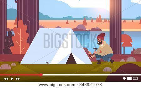 Hiker Blogger Recording Online Video Man Vlogger Setting Up Tent At Campsite Live Streaming Blogging