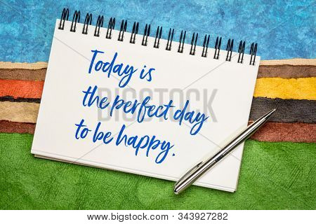 Today is the perfect day to be happy  inspirational quote - handwriting in a sketchbook against colorful abstract landscape. Pep talk, happiness and positivity concept.