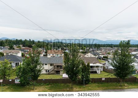 Abbotsford, Canada - June 9, 2019: Residential Area With Mountains On The Background.