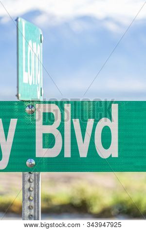 Selective Focus On A Green And White Road Street Sign That Reads Blvd