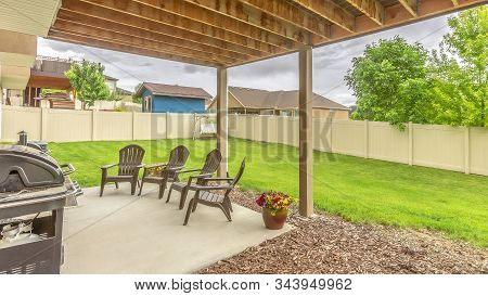 Panorama Patio At The Backyard Of A Home With Roof Columns Chairs And Barbecue Grill