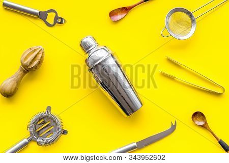 Bartender Equipment Set With Shaker And Stainer On Yellow Background Top-down