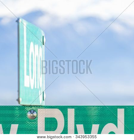 Square Selective Focus On A Green And White Road Street Sign That Reads Blvd