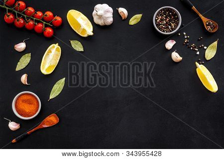 Kitchen Frame With Spices And Food - Pepper, Garlic, Cherry Tomatoes - On Black Background Top-down