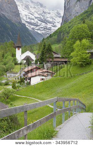 Church In Lauterbrunnen Valley, Switzerland. Idyllic Landscape