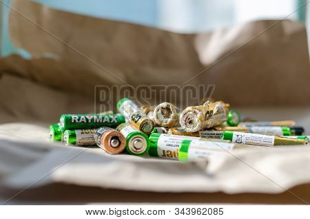 Nikolaev, Ukraine - September 12, 2019: A Group Of Used Batteries Of Sizes Aaa And Aa. Close-up. Sel