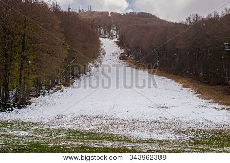 Ski Slope With Little Snow During Warm Winter. Greenhouse Effect Concept. Ski Resort Amiata Mountain