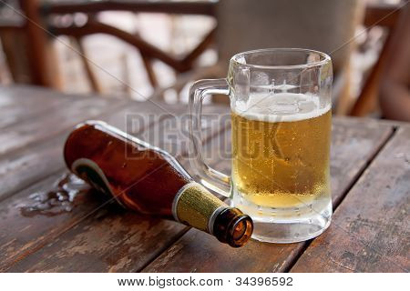 Empty Bottle And The Glass Of Beer