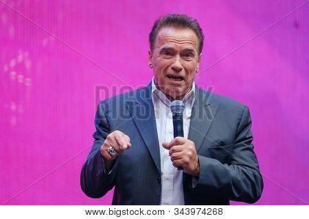 Saint Petersburg, Russia - October 4, 2019: Arnold Schwarzenegger, famous actor, politician and businessman, speaks at a business forum