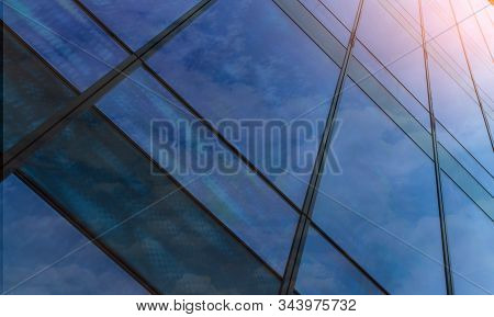 Perspective View Of Modern Futuristic  Glass Building Abstract Background. Exterior Of Office Glass