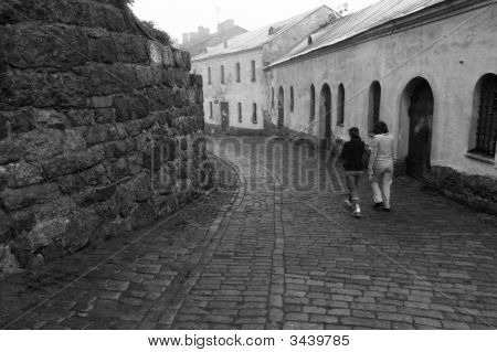Two Womens Walking In Castle