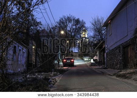 Voronezh, Russia - December, 31, 2019: image of the road between residential buildings at night in Voronezh