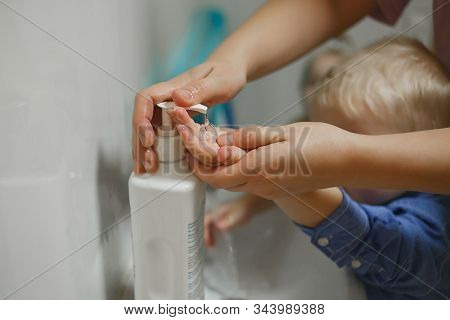 Toddlers Wash Their Hands In A Washstand In Kindergarten. Concept Of Hygiene, Professional Childcare