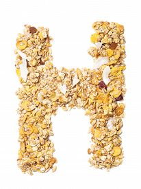 Letter H Of The English Alphabet Muesli With Coconut, Berries, Raisins, Cereal And Natural Cereals
