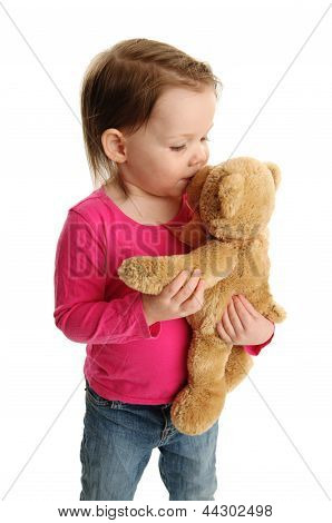 Little Girl Kissing Teddy Bear