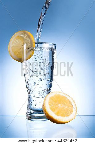 Mineral Water Glass With Lemon On A Blue Background