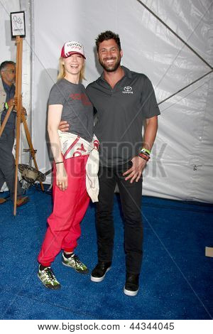 LOS ANGELES - APR 9:  Jenna Elfman, Maksim Chmerkovskiy at the Toyota ProCeleb Race Press Day 2013 at the Toyoto Grand Prix Circuit on April 9, 2013 in Long Beach, CA