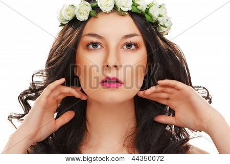woman with ideal skin and flower