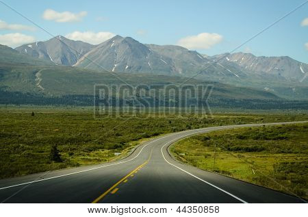 A lonely highway in the north western most part of British Columbia, between Haines, Alaska and Haines Junction, Yukon. poster