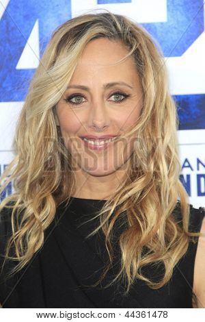 LOS ANGELES - APR 9: Kim Raver at the Los Angeles Premiere of '42' at TCL Chinese Theater on April 9, 2013 in Los Angeles, California