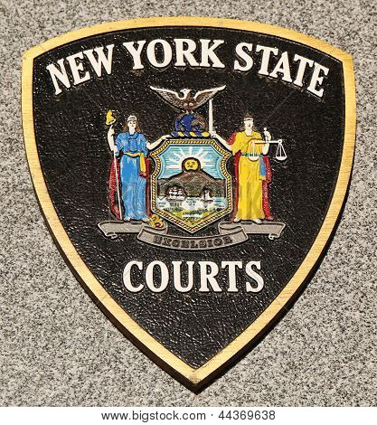 New York State Courts emblem on fallen officers memorial in Brooklyn, NY.