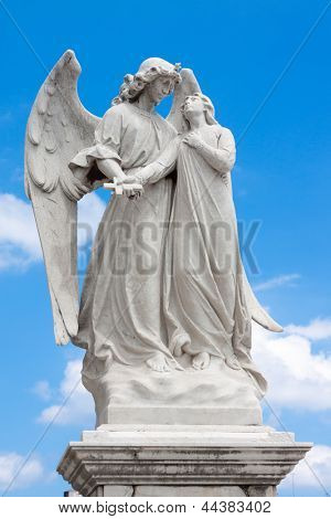 Marble statue of a winged angel guarding a beautiful young girl