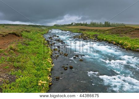 Summer Iceland Landscape With Raging River