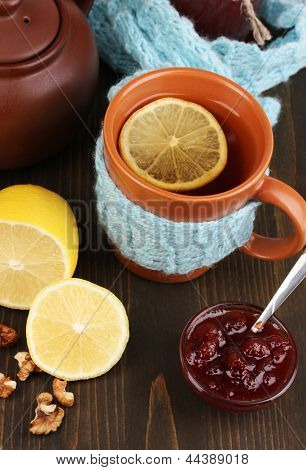 Helpful tea with jam for immunity on wooden table close-up