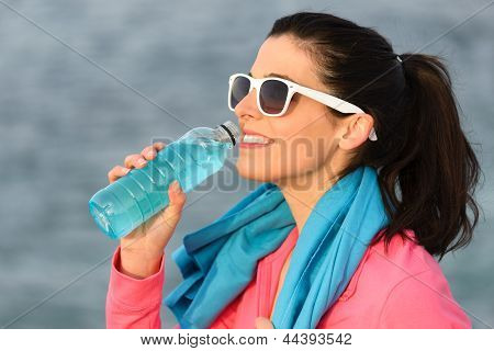 Fitness Woman Drinking After Sport Training