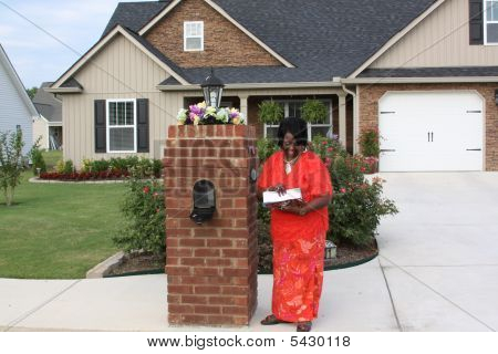 Black Homeowner With Mail