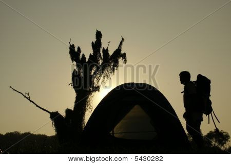 Camping Tent Outdoors With Man Silhouette