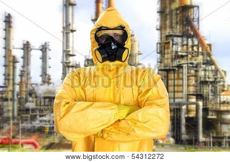 Man in chemical protective suit over factory poster