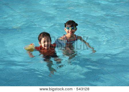 Girl & Boy In The Pool