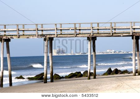 Beach view of fishing pier