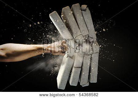 Close up of human hand breaking bricks