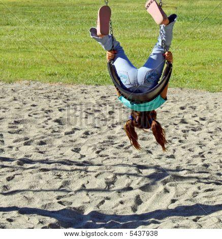 Child Swings Upside Down