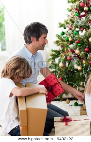 Father And His Boy Opening Christmas Presents