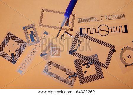RFID tags and implantation syringe