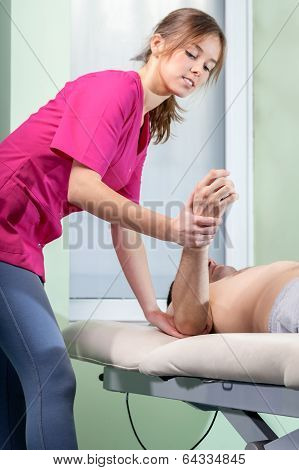 Physiotherapist Treating Tennis Elbow