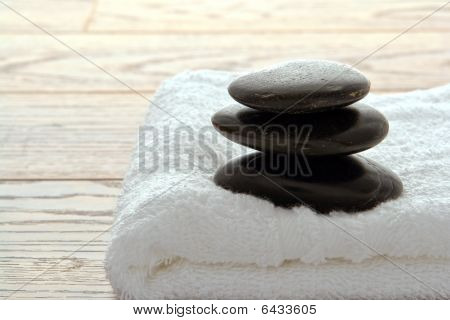 Polished Stone Cairn On A Towel In A Spa
