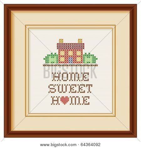 Embroidery, Home Sweet Home with a big heart in rustic colors, needlework house in landscape graphic cross stitch sewing design isolated on white background, beige mat, mahogany picture frame. poster