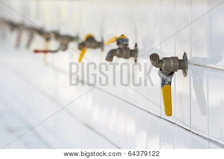 Water Taps In A Public Shcool Of Si Sa Ket, Thailand