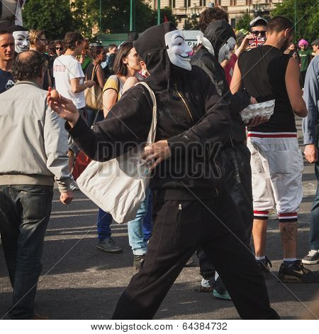 Protester Throwing An Egg During Mayday Parade In Milan, Italy