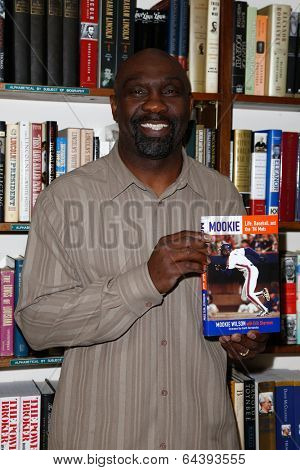HUNTINGTON, NY-MAY 2: Former MLB player Mookie Wilson signs his book 'Mookie: Life, Baseball, and the '86 Mets' at The Book Revue on May 2, 2014 in Huntington, NY.