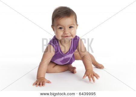 Baby girl crawling towards the camera