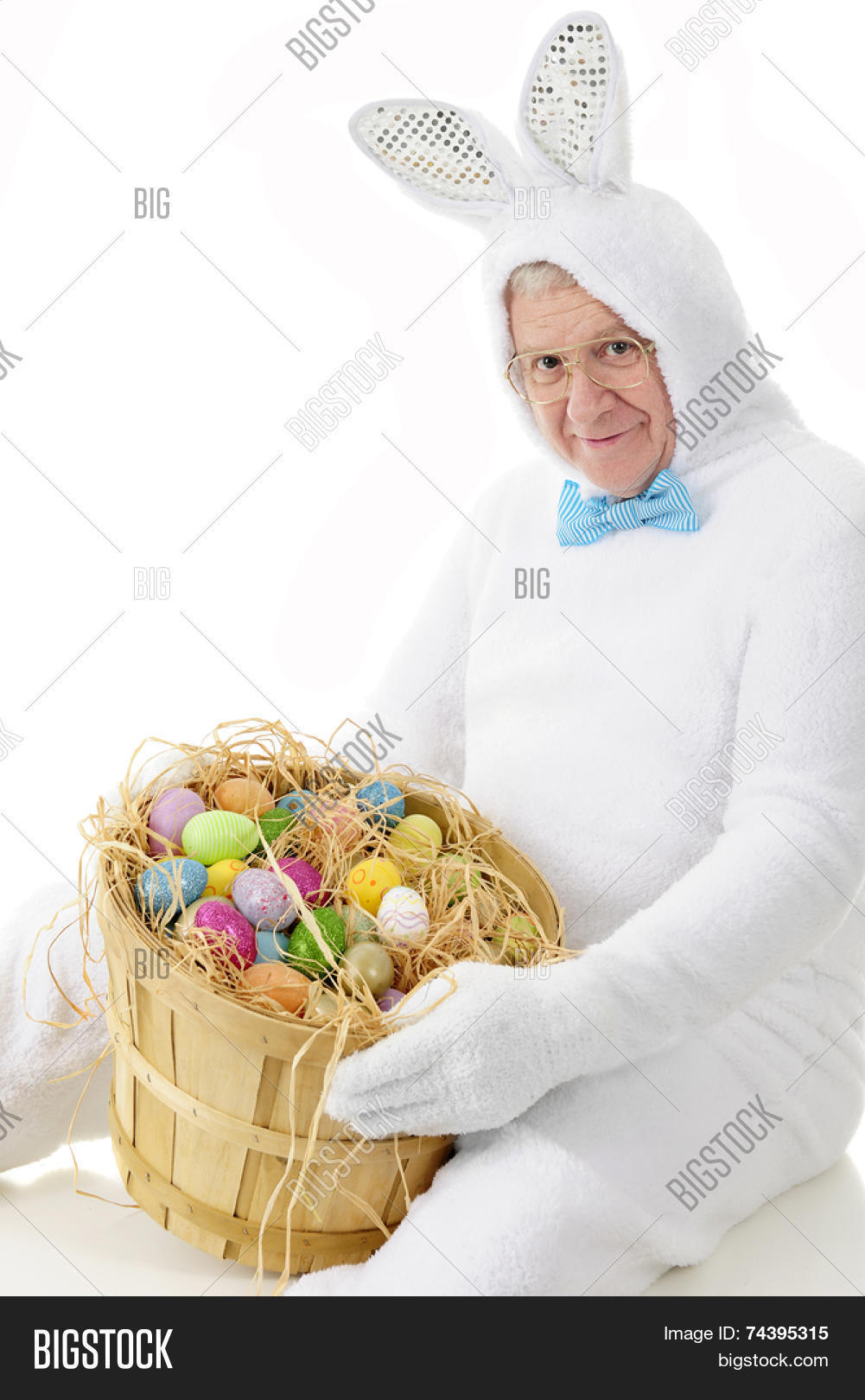 Senior adult man image photo free trial bigstock a senior adult man in an easter bunny outfit happily showing off a bushel of colorful negle