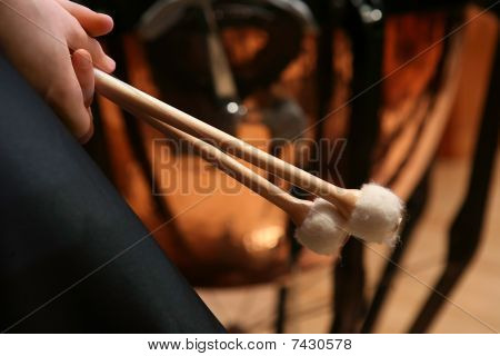 Close-up of pair of hands holding drumsticks