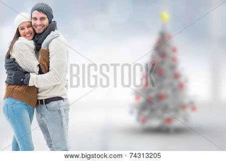 Young winter couple against blurry christmas tree in room poster